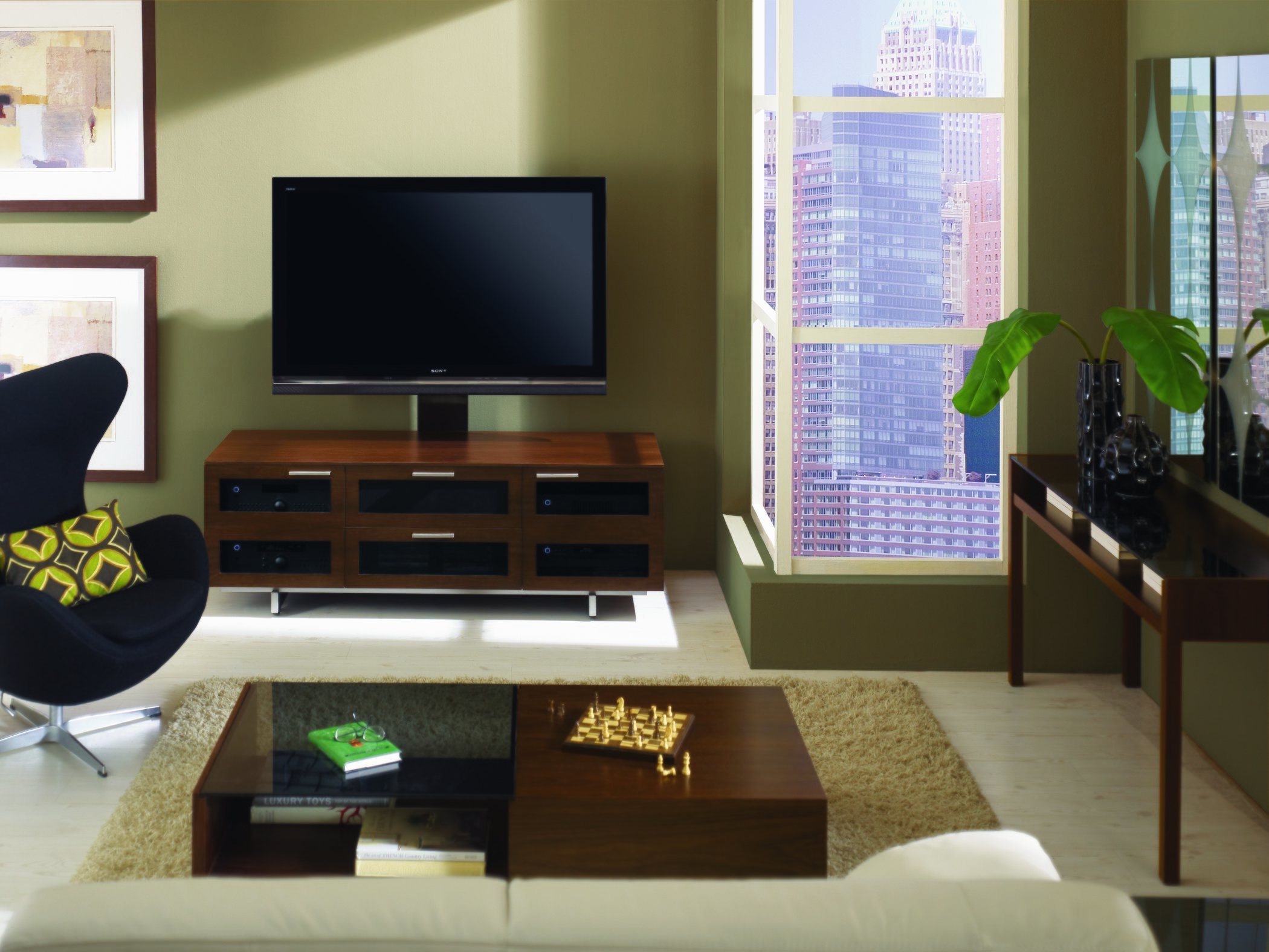 lifestyle photo of the avion tv stand from bdi in chocolate stained walnut